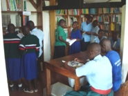 Students group selecting books 2_185x139.jpg