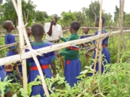 Students in field with Enock_185x139.jpg